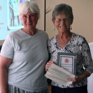 Sherry Watts (Left) presents June-Marie Provost with her Canadian Masters Athletics Hall of Fame Plaque